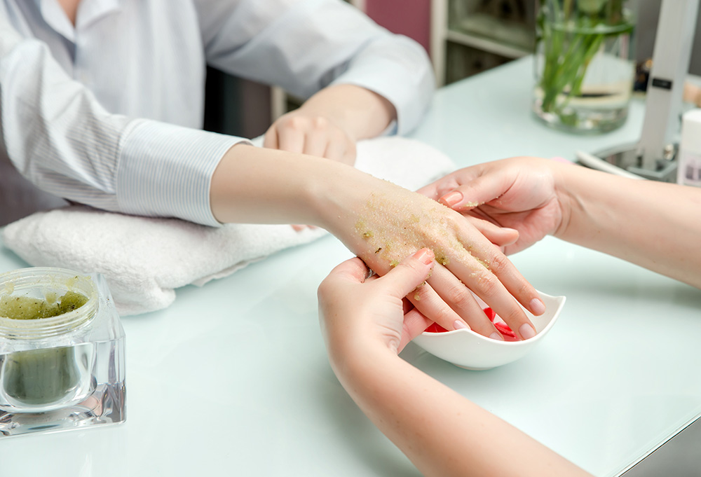 Woman receiving professional manicure.