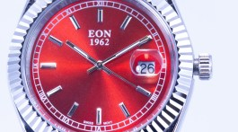 Close up of red watch dial.