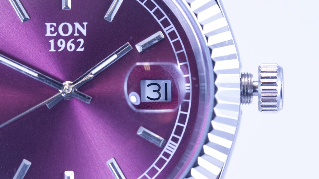Close up of purple watch dial.