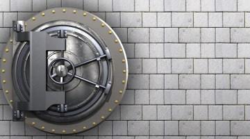 Closed Vault against grey brick wall
