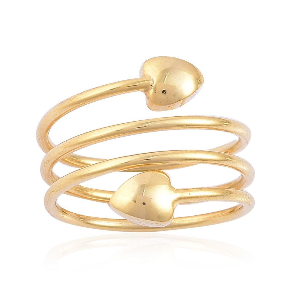 Closeup of gold spiral heart ring.