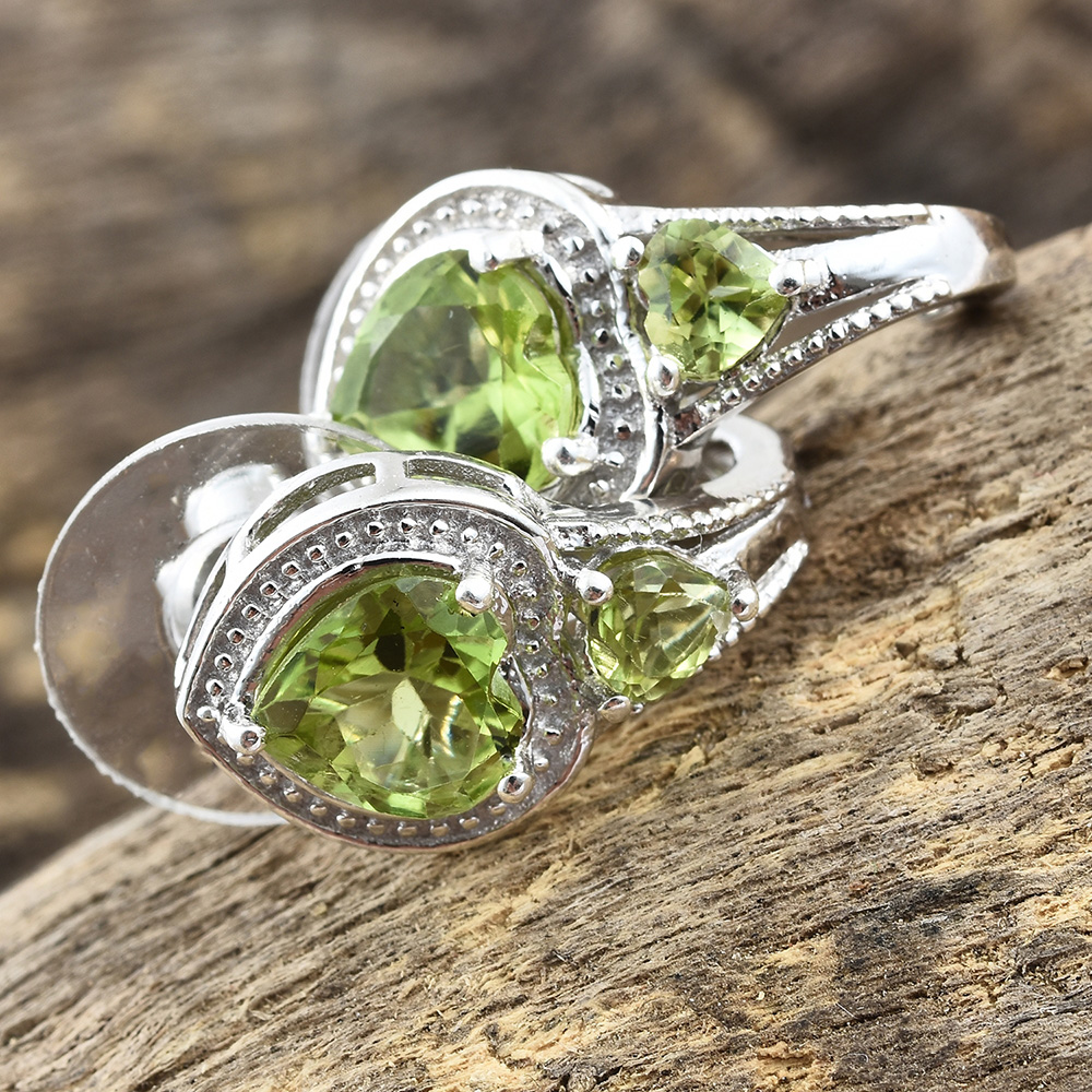 Closeup of peridot earrings against