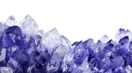 Blue sapphire crystals against white background
