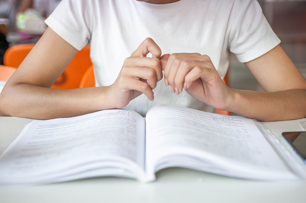 Closeup of child studying.