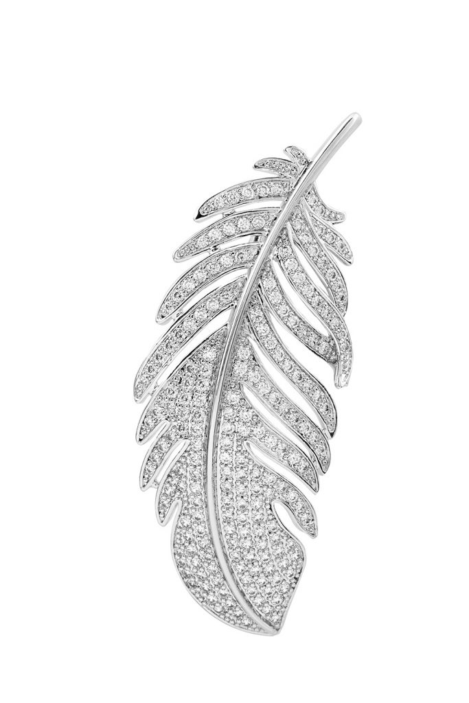 Closeup of silver feather brooch