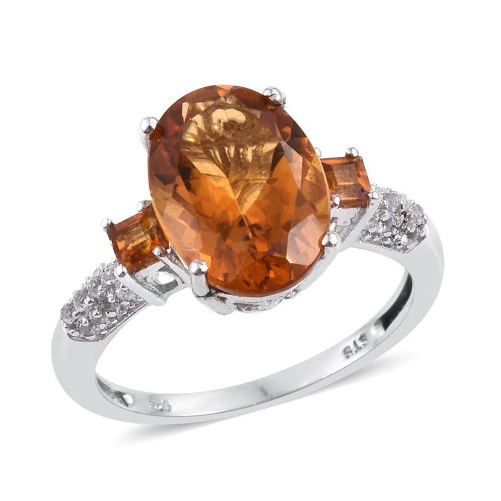 Closeup of citrine ring with silver band