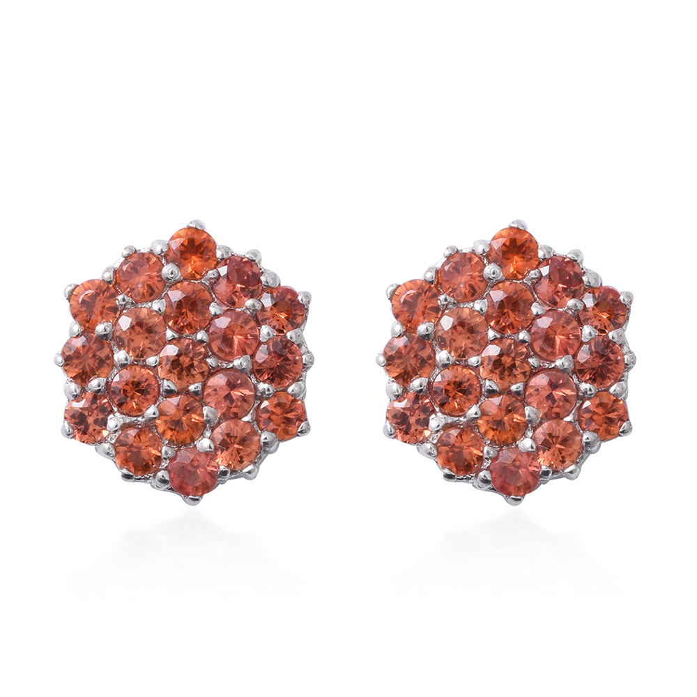 Closeup of orange sapphire cluster earrings