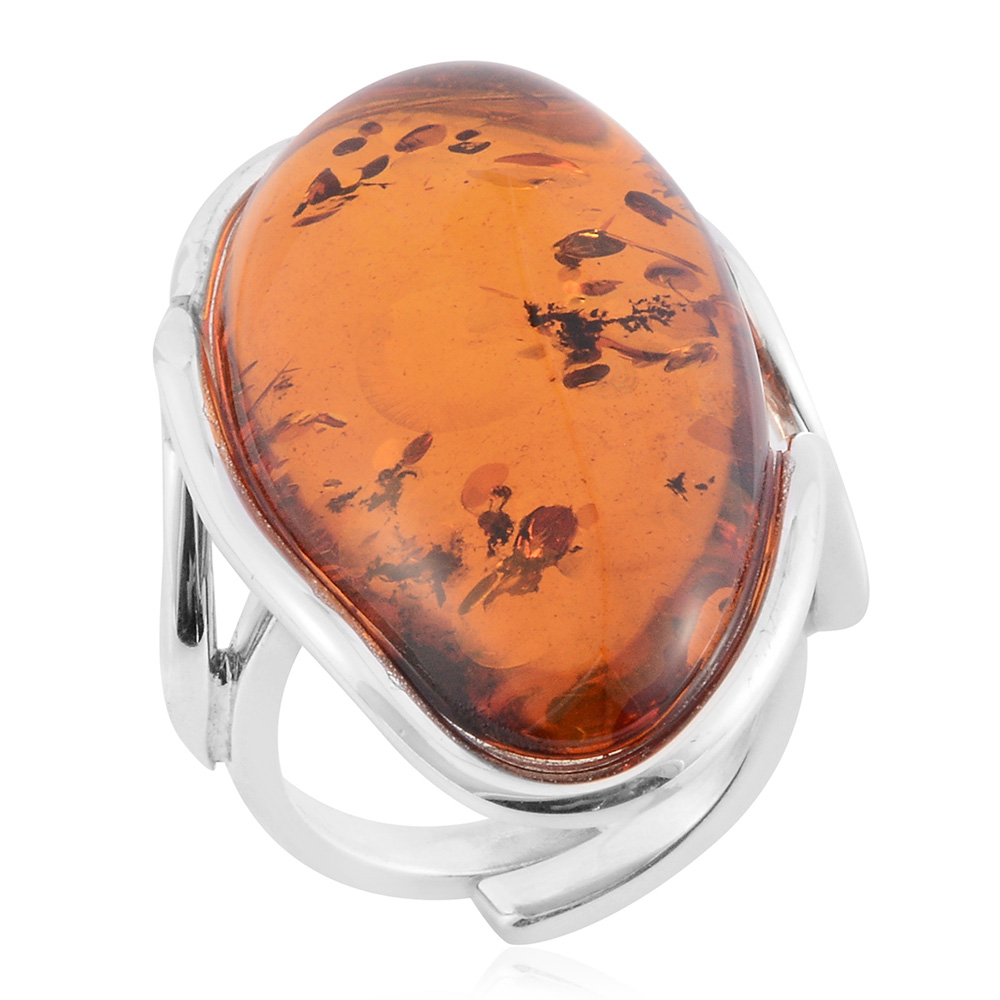 Closeup of orange baltic amber ring