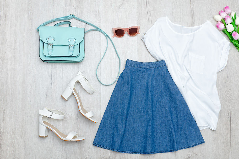 Flat lay of outfit with dark skirts and white T-Shirt