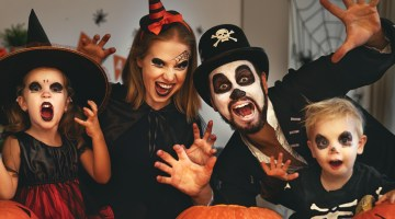 Happy family dressing up for Halloween