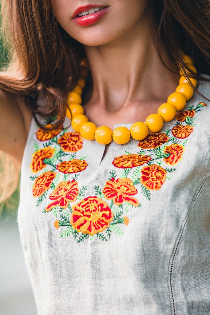 Marigold beads paired with floral vest