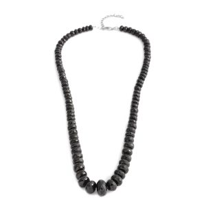 Black spinel bead necklace on white background.