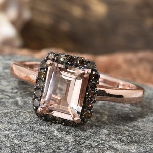 Morganite ring in rose gold vermeil on granite stand.
