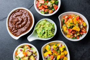 Assortment of colorful and fresh salsas.