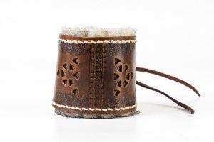 Replica Roman leather bracelet on white background.