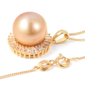 Golden south sea pearl pendant on white background.