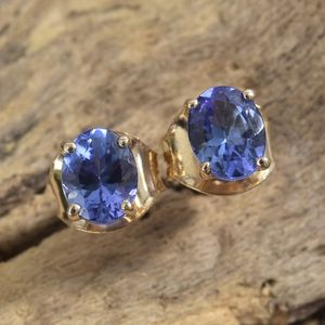 AAA tanzanite post back earrings in yellow gold.