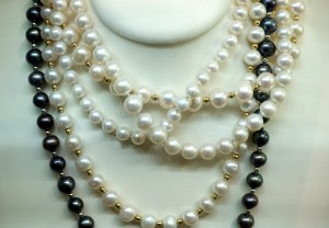 Pearl strands on bust.