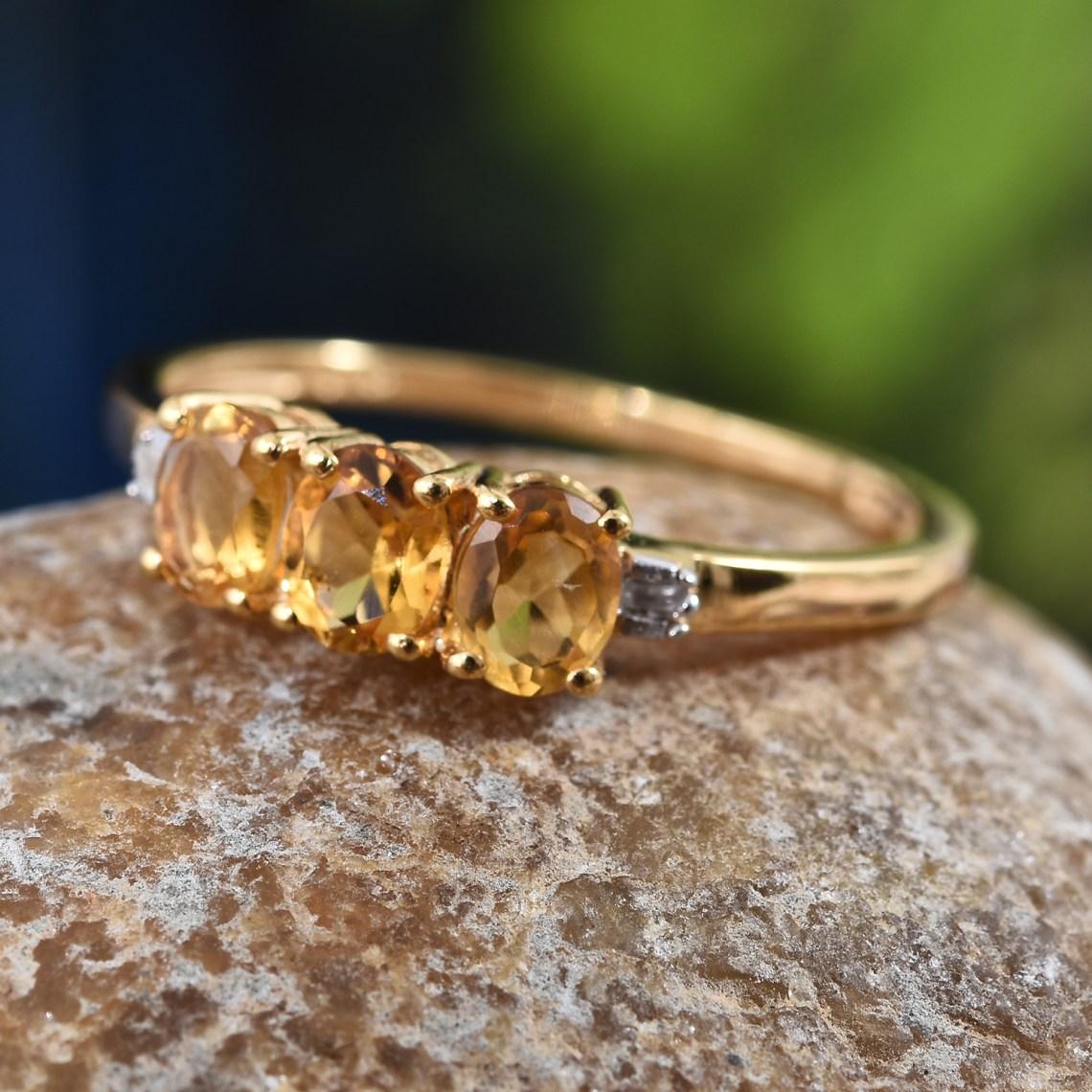Three stone yellow citrine birthstone ring.