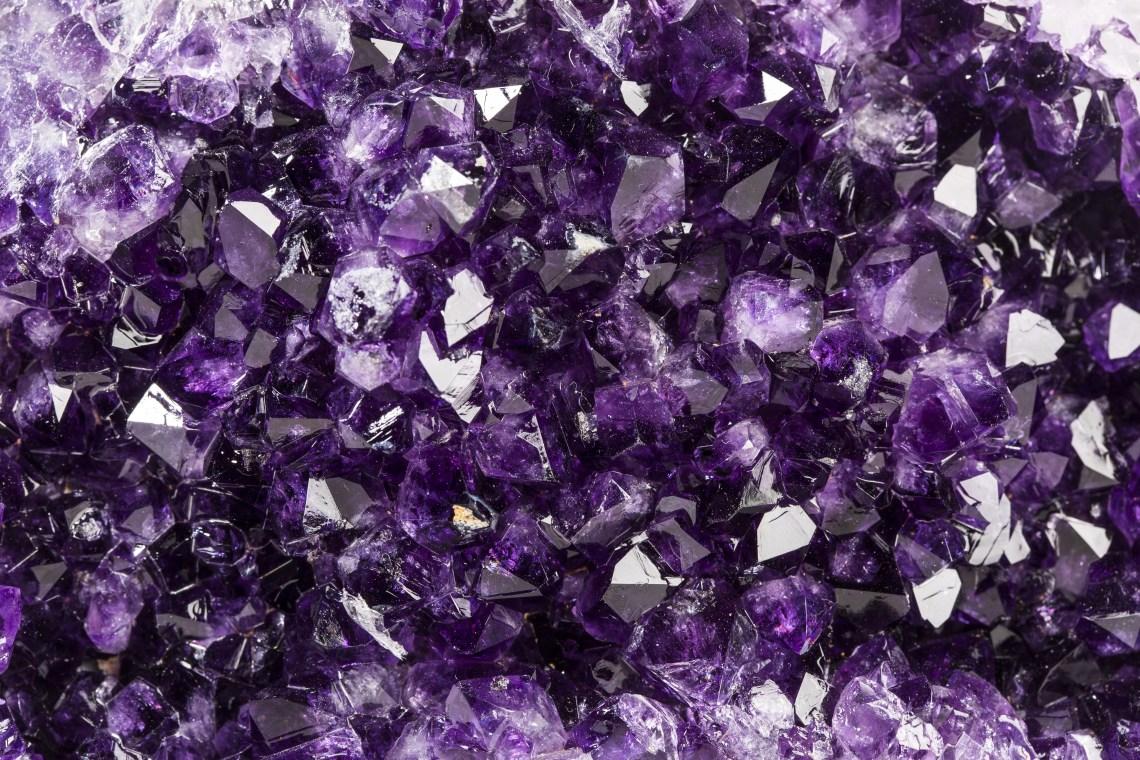 Closeup of deep purple amethyst crystals.