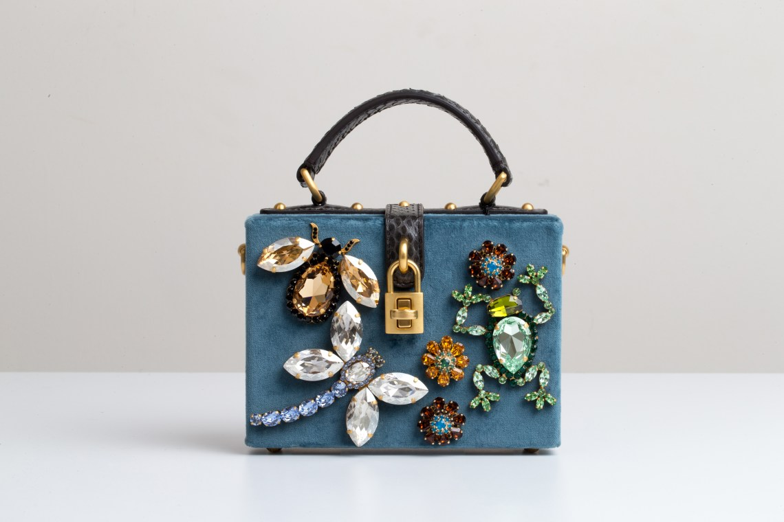 DIY bedazzled purse featuring huge gems in animal shapes.