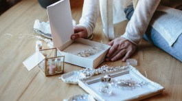 Woman sorting jewelry for DIY projects.