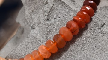 Faceted fire opal beads in hombre style.