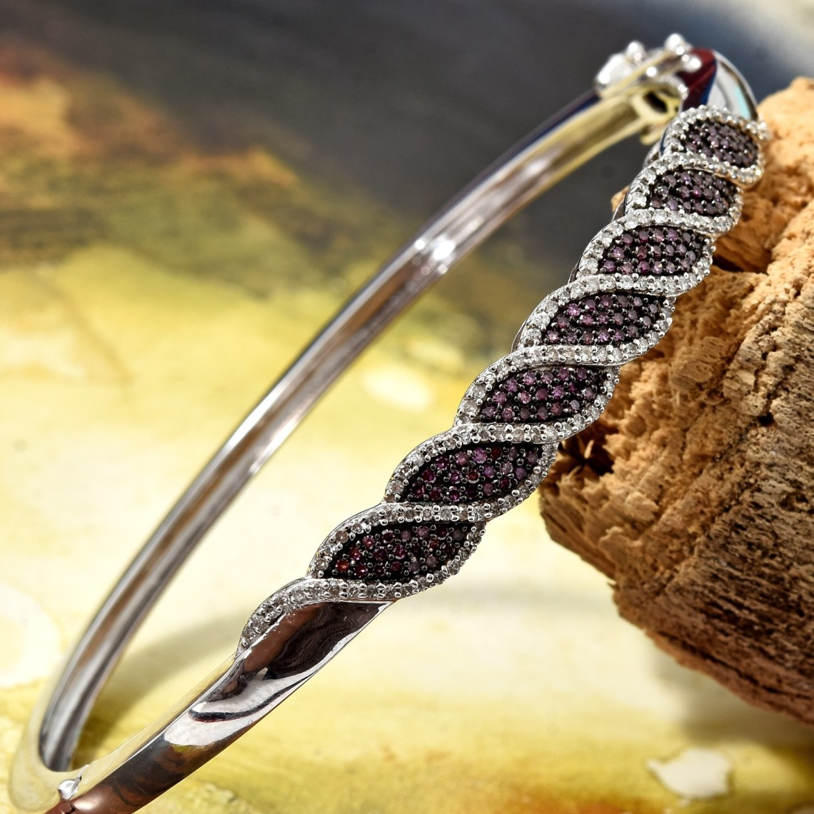 Purple diamond bangle bracelet displayed artfully.