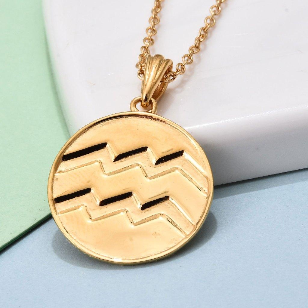 Gold Aquarius pendant.