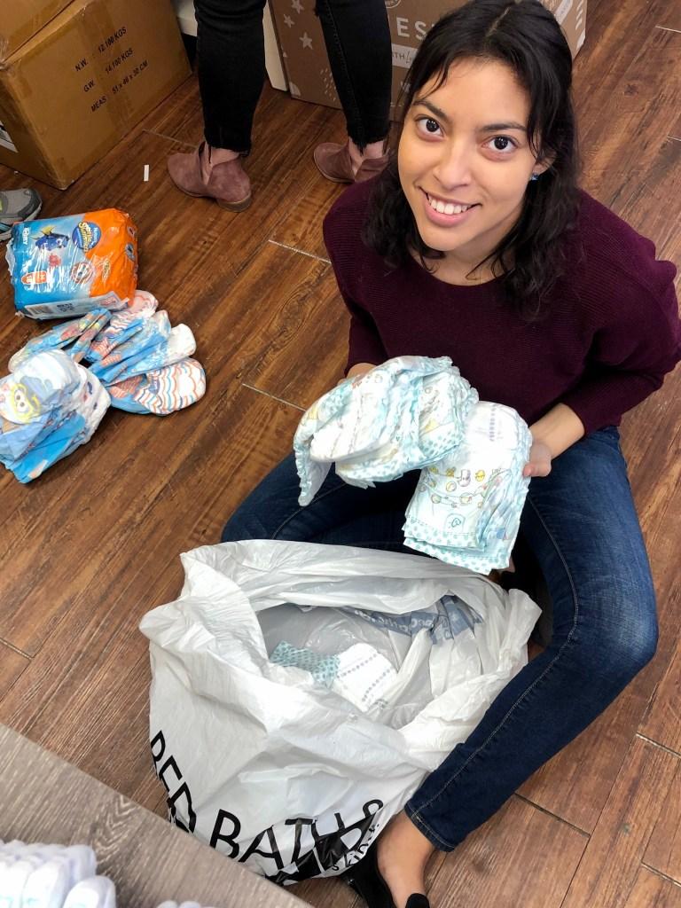Volunteers pack diapers.