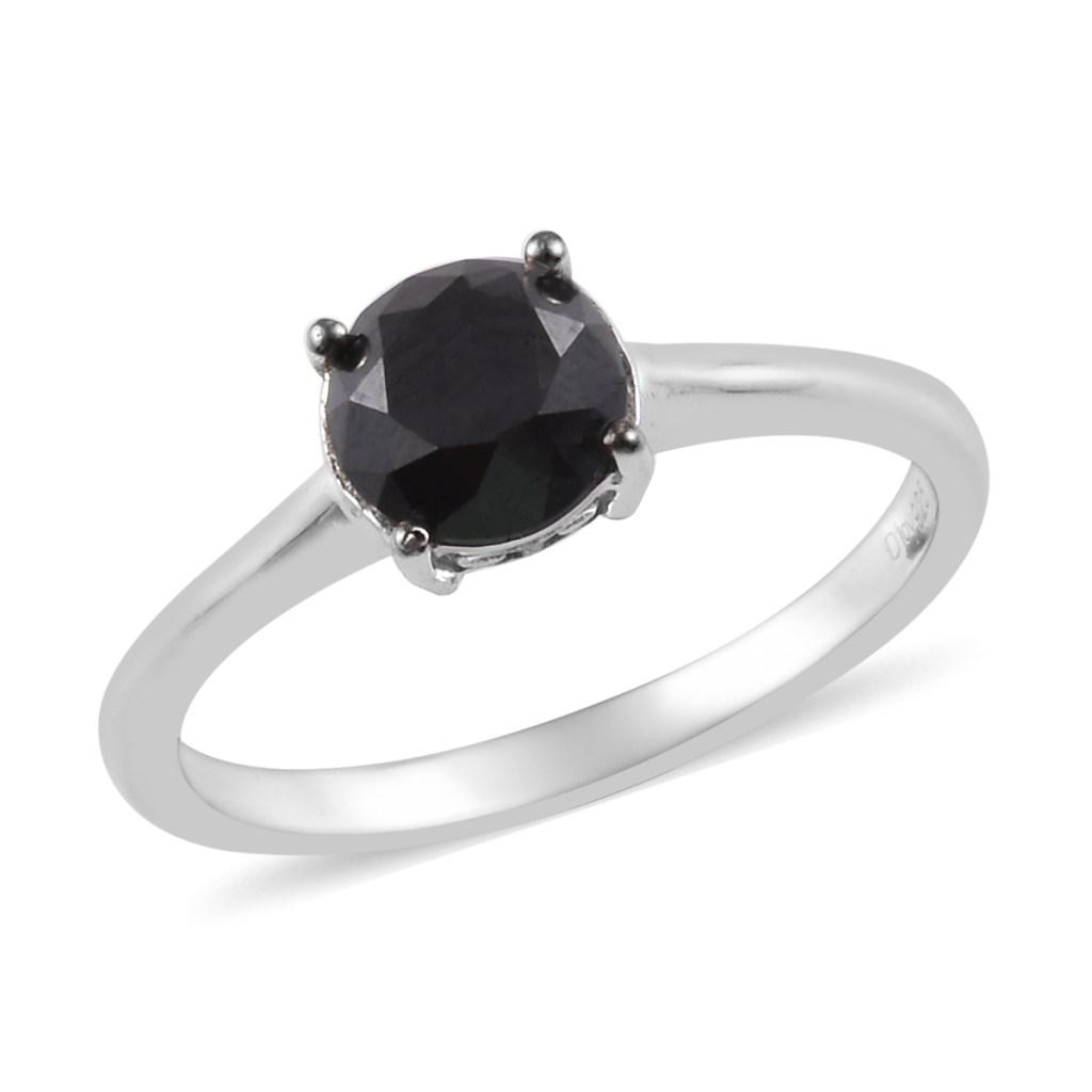 Black diamond solitaire ring.