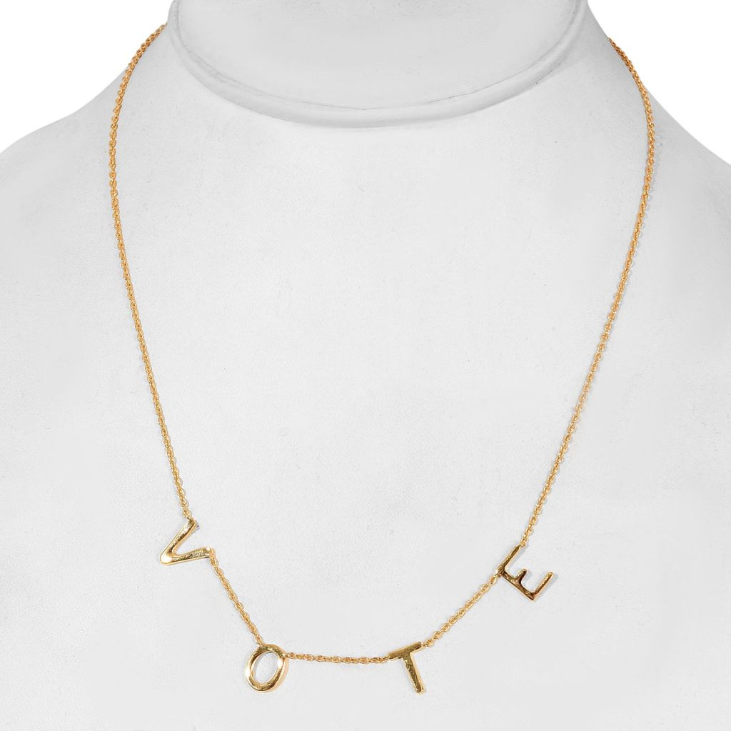Vote necklace in yellow gold.
