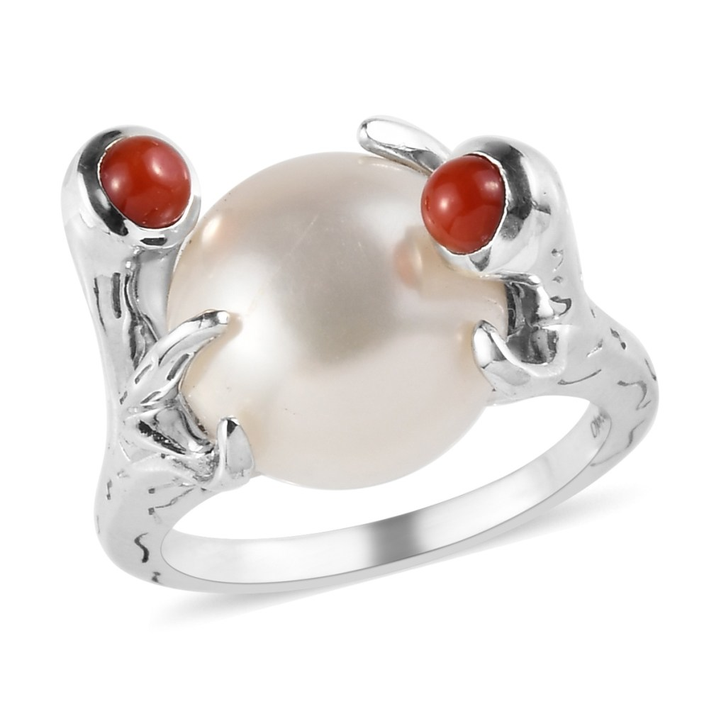 Pearl ring in custom setting with coral accents.