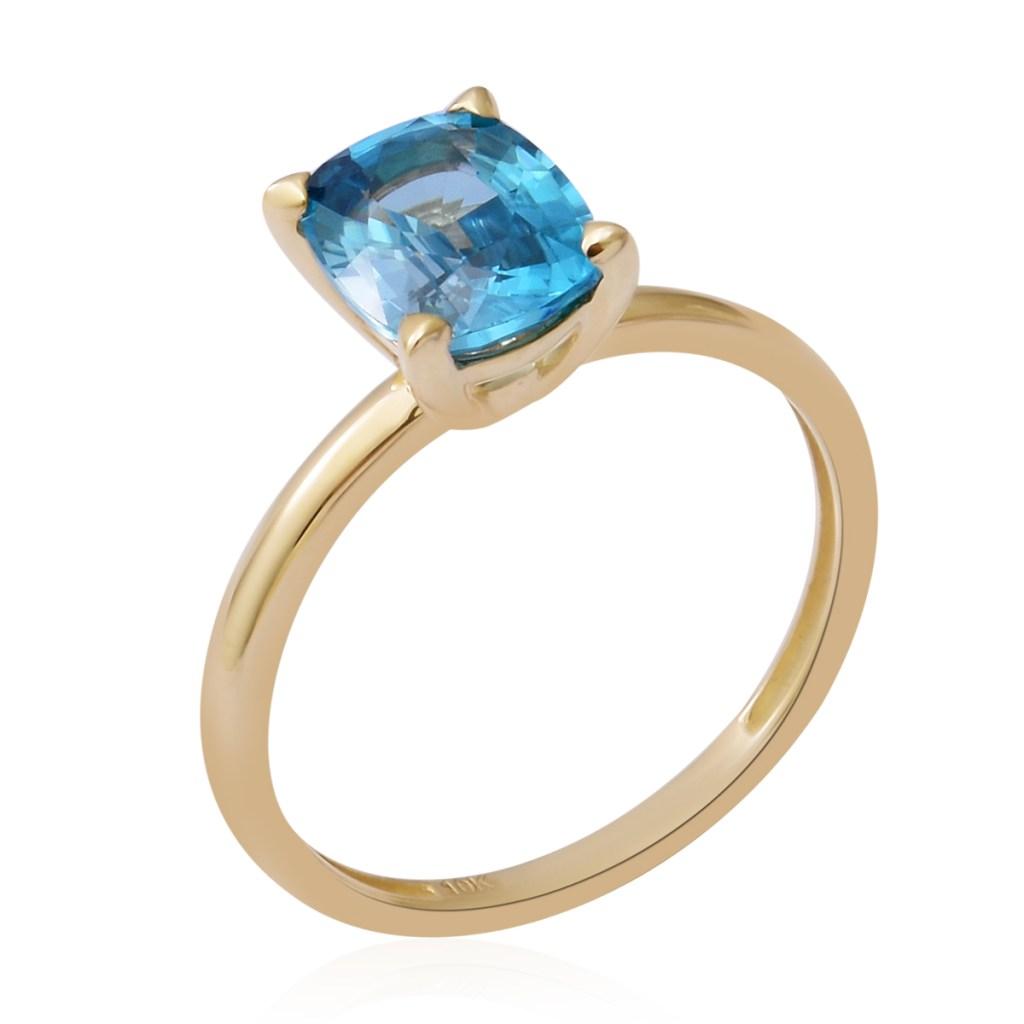 Blue zircon gold engagement ring.