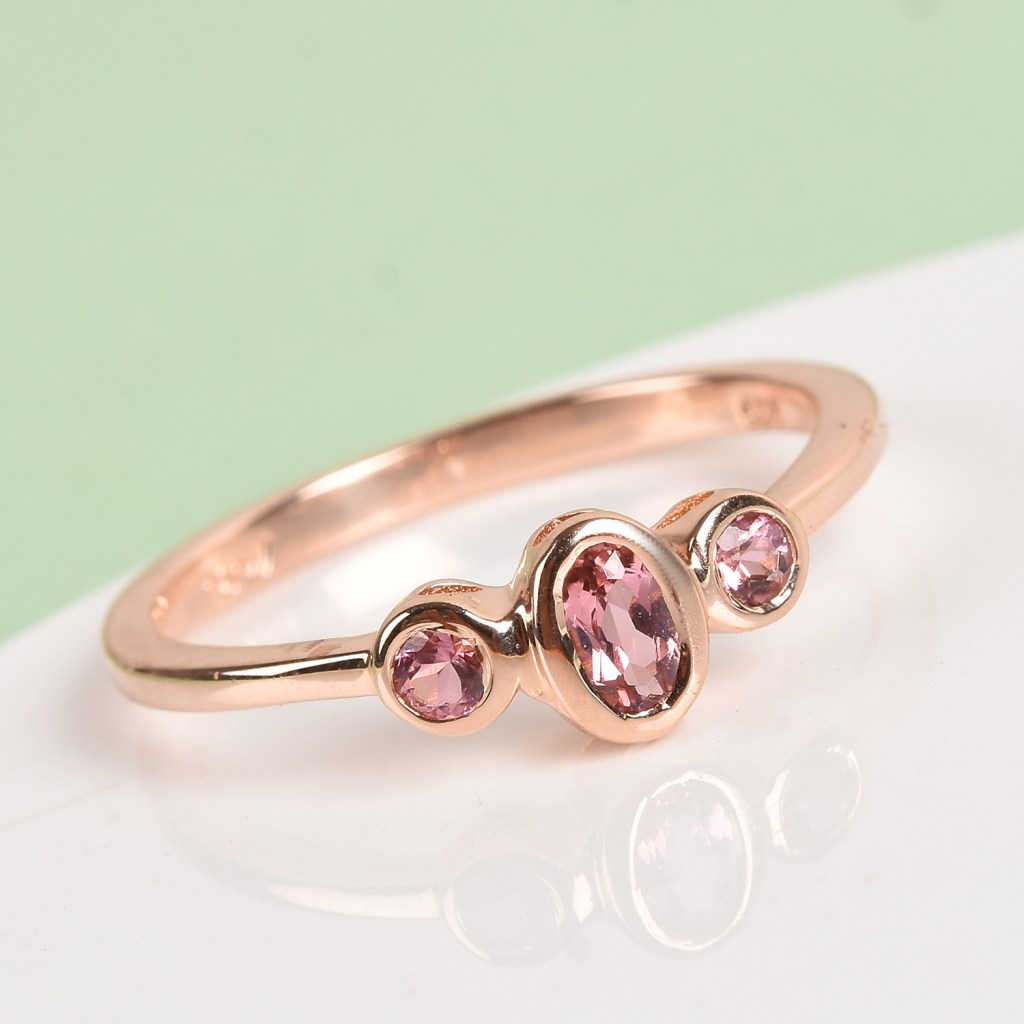 Pink three stone ring.