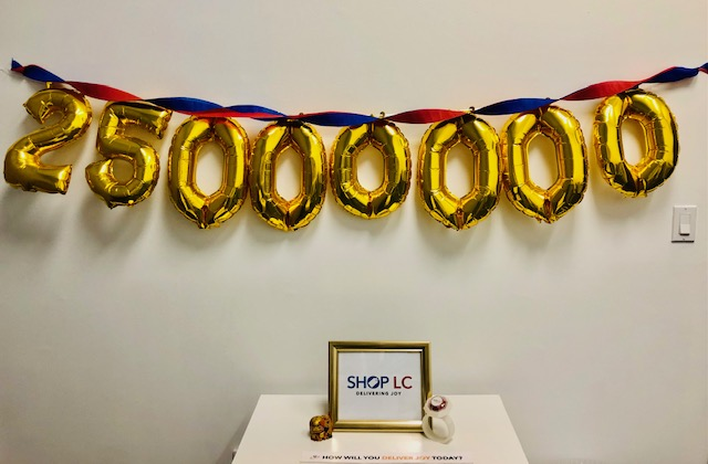 Gold balloons showing 25 million meals provided by Shop LC.
