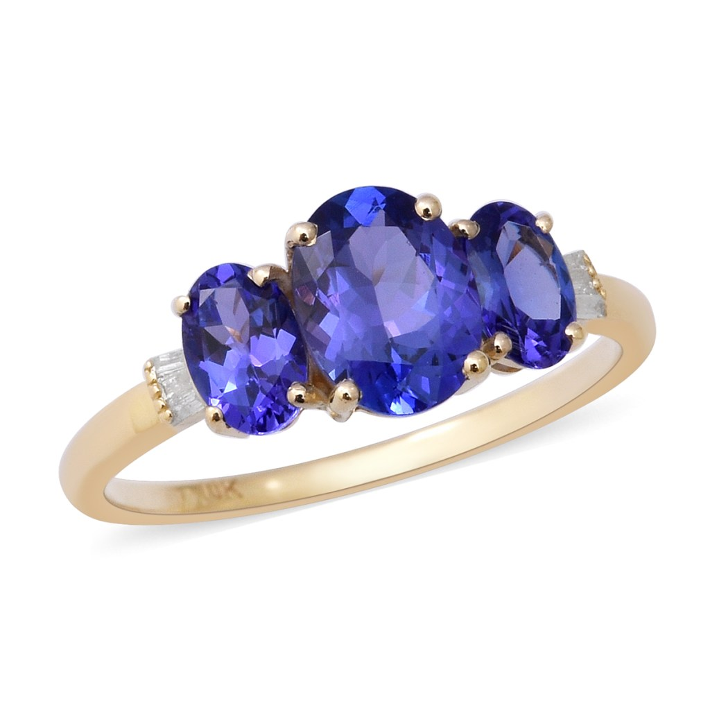 Blue three stone ring in genuine yellow gold.