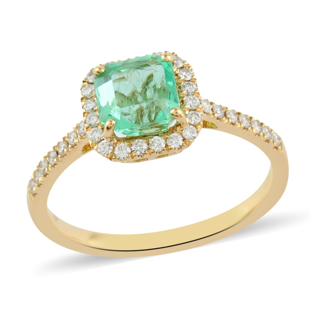 Colombian emerald halo ring set in 18K yellow gold.