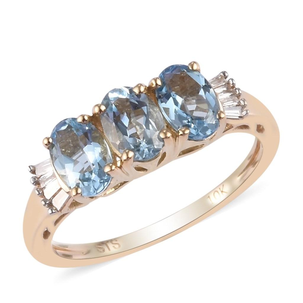 Three stone gold aquamarine ring.