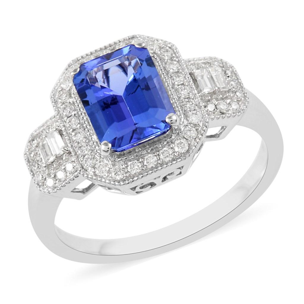 Tanzanite ring with diamond accents in platinum.