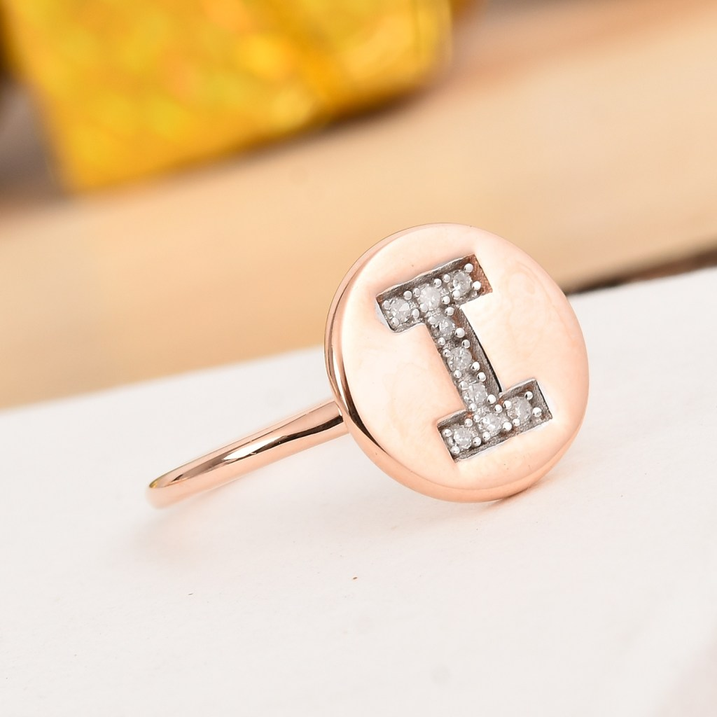 Diamond initial ring with 14K rose gold finish.