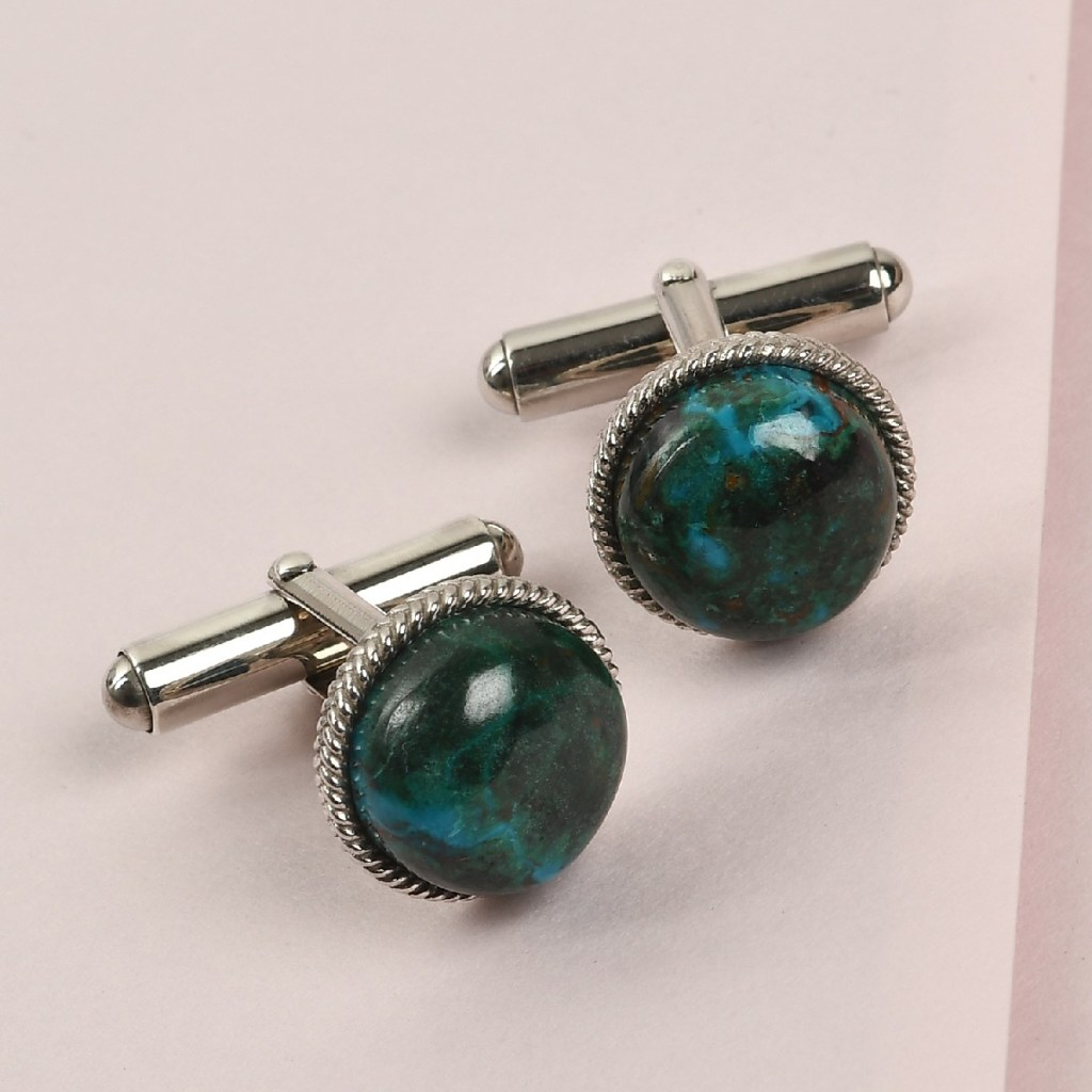Sterling silver cufflinks with blue green gemstone accents.