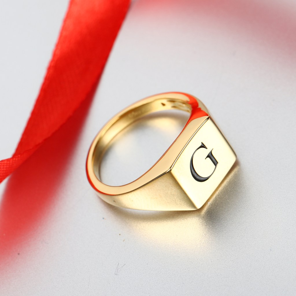 """Gold vermeil men's ring engraved with the initial """"G."""""""