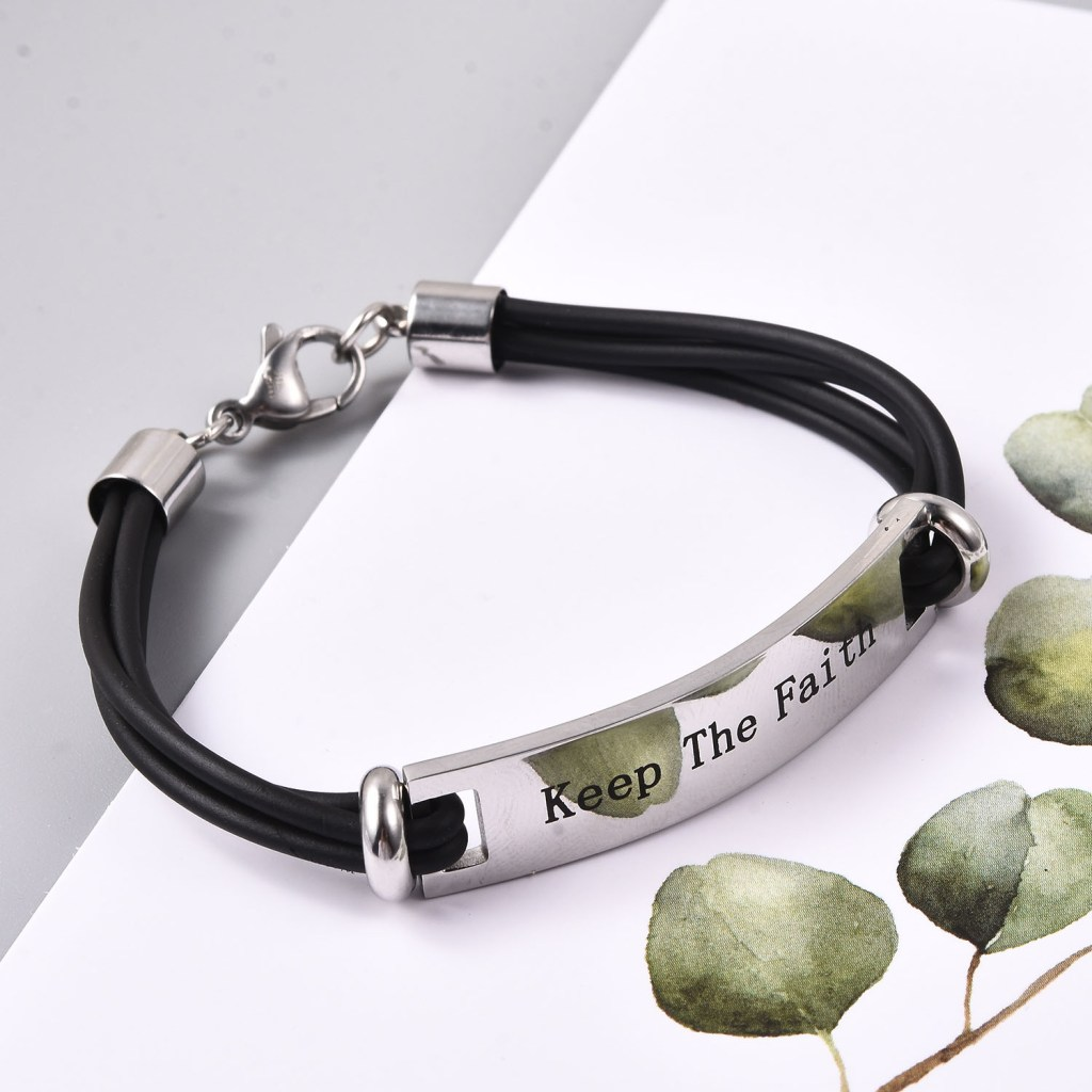 """Silicone bracelet with stainless steel plate, engraved with """"Keep The Faith."""""""
