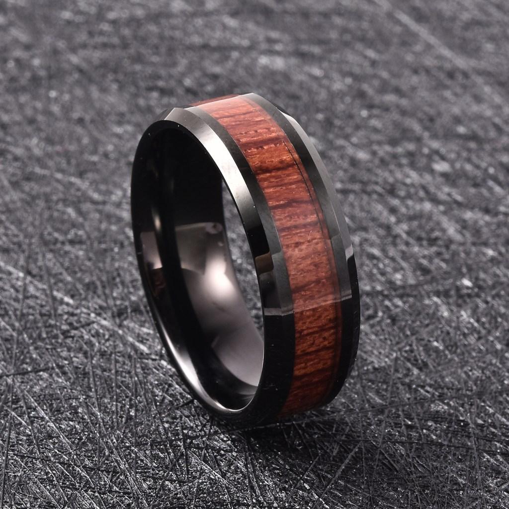 Tungsten band ring with acacia wood inlay.