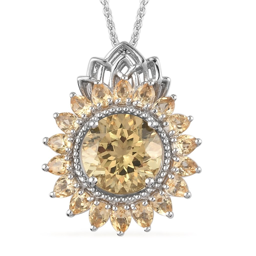 Yellow gemstone starburst pendant.