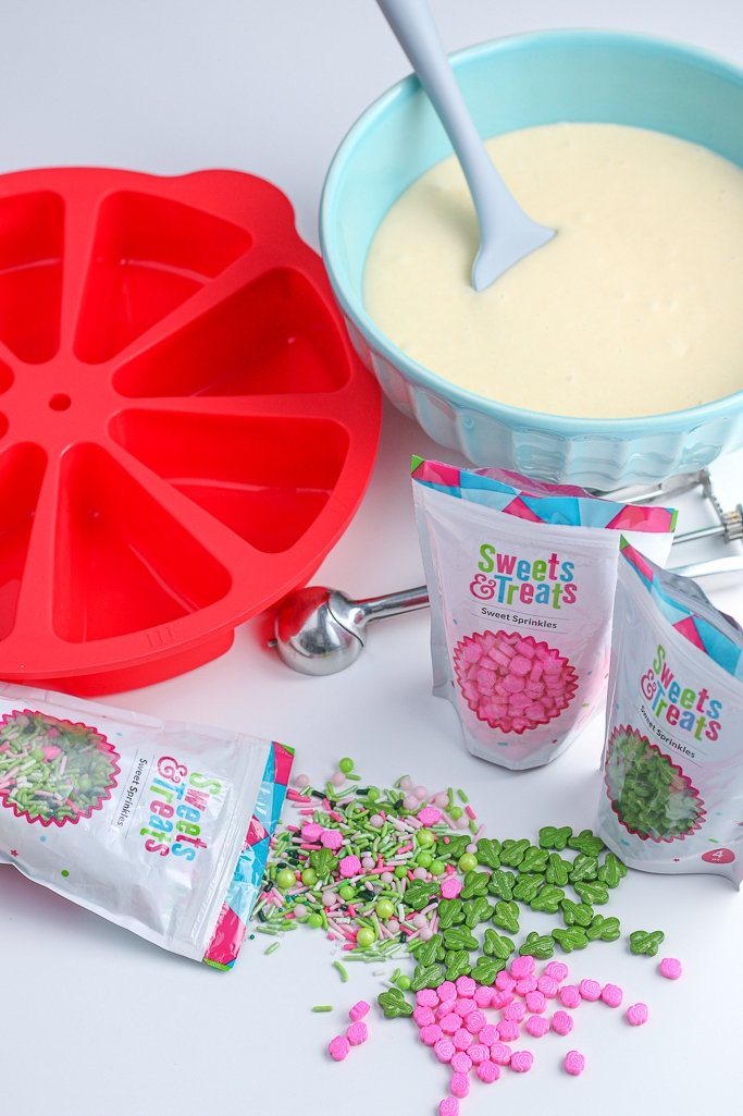 Ingredients needed to make cake pizzas laid out before begin baking.