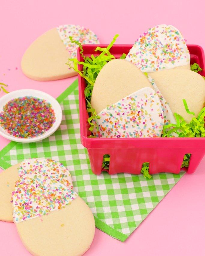 egg cookies with sprinkles in a pink basket