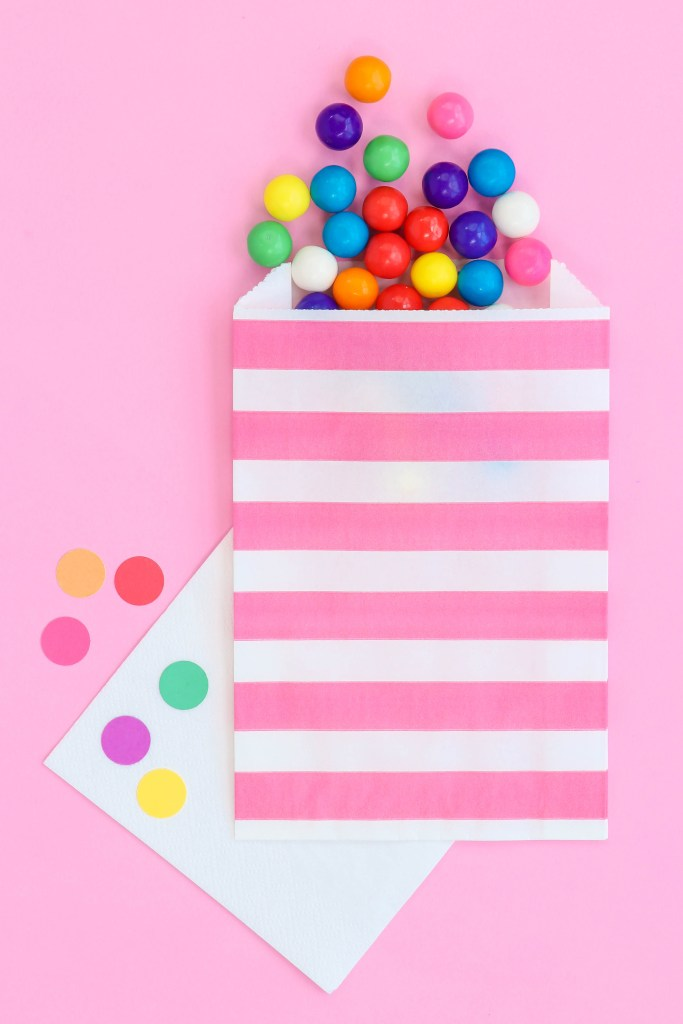 Circus animal cookies party favors - Pink stripe paper favor bags with gumballs pouring out