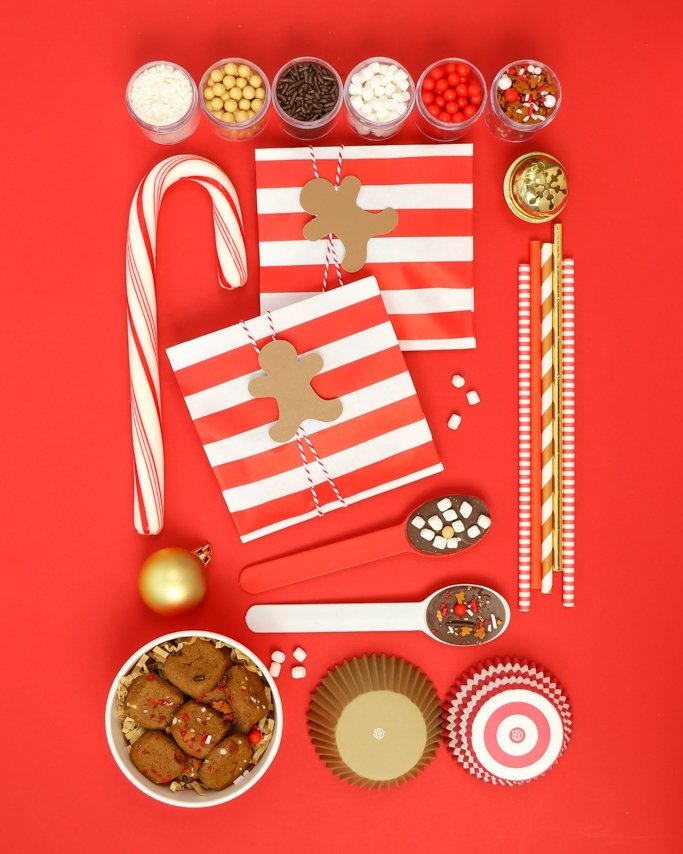 Cocoa & Cookies Christmas Party Ideas - Gingerbread party supplies on red background